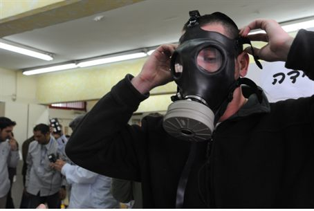 Man tries on gas mask (illustrative)