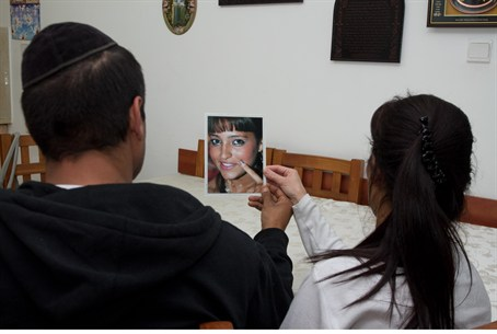 Shalom and Sigal Ben Hamou with a picture of