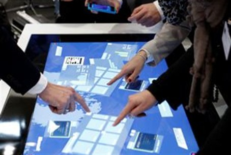 Touch screens at booth of Microsoft at comput