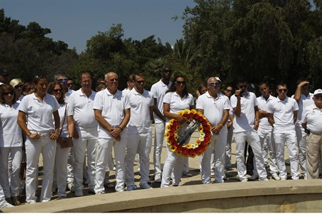 Members of the Israeli Olympic delegation sta