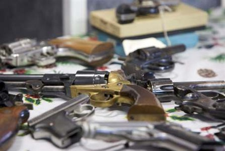 Handguns turned in are seen during a gun buyb