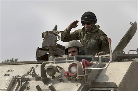 IDF soldiers in an armored personnel carrier