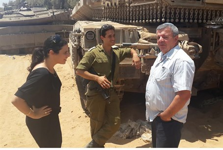 Shaked(L( and Calfa visit an IDF soldier on t