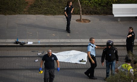 Police surround terrorist's body after Pisgat Ze'ev stabbing