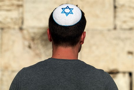 Religious Jewish man wears a kippah at the Kotel