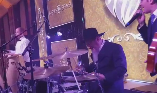 Chief Rabbi of Russia Berel Lazar plays the drums at his son's wedding
