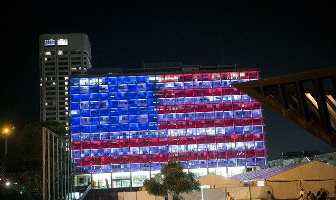 Tel Aviv city hall lit up with the American flag