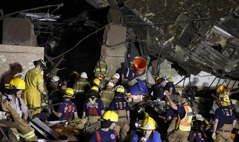 rescue workers dig through rubble after Oklah
