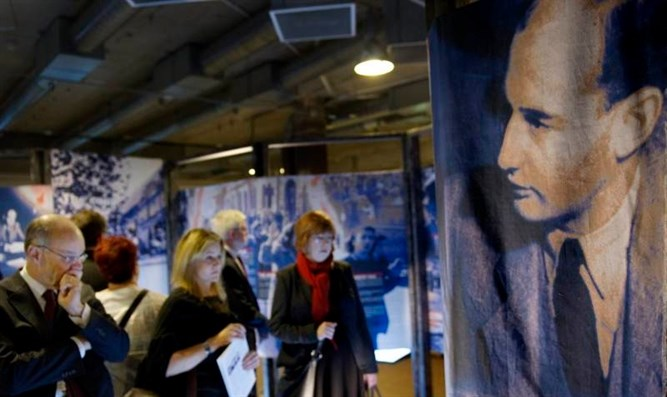 Visitors watch a photo exhibition of Raoul Wallenberg
